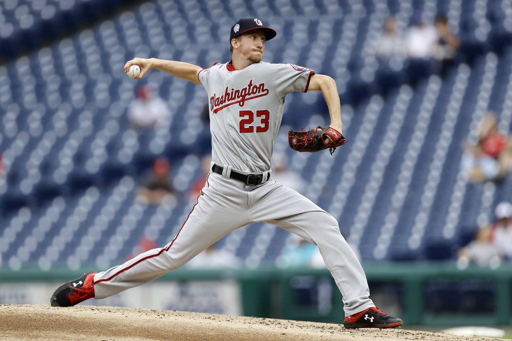 Washington Nationals' Erick Fedde pitches during the third inning of the first game of a baseba ...