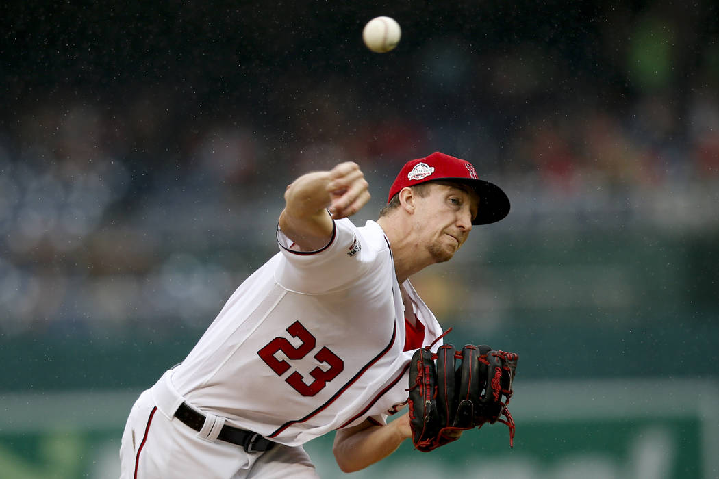 Washington Nationals pitcher Erick Fedde pitches in the first inning of a baseball game against ...