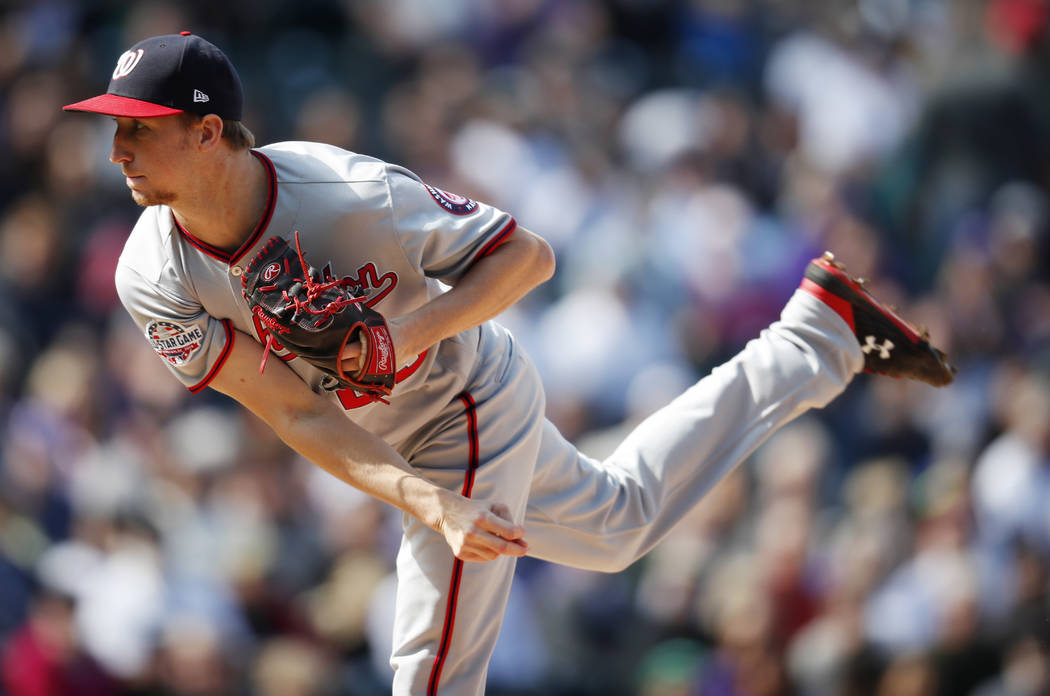 Washington Nationals relief pitcher Erick Fedde works against the Colorado Rockies in the first ...