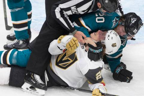 Golden Knights center Cody Eakin (21) gets in a fight with San Jose Sharks left wing Marcus Sor ...