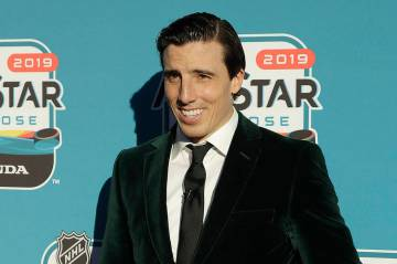 Vegas Golden Knights' Marc-Andre Fleury poses for photos before the Skills Competition for the ...