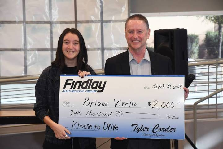 West Career and Technical Academy graduating senior Briana Virella is seen receiving a check fo ...