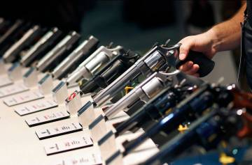 Handguns are displayed at the Smith & Wesson booth at the Shooting, Hunting and Outdoor Trade S ...