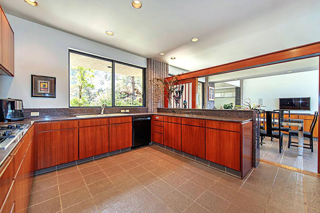 The kitchen features teak cabinetry. (Luxury Estates International)