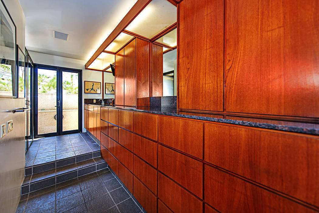Teak cabinetry lines the hallway. (Luxury Estates International)
