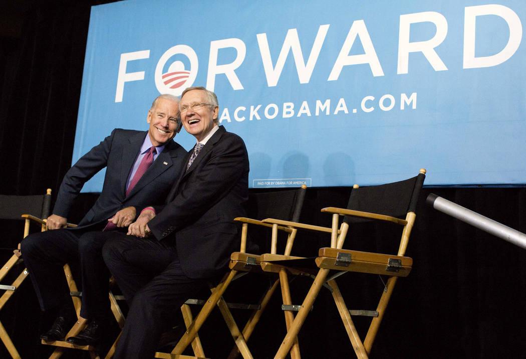 Vice president Joe Biden, left, and Senate Majority Leader Harry Reid of Nev. react to cheers f ...