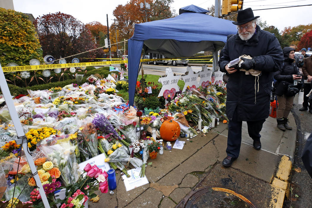 Rabbi Chuck Diamond arrives on the street corner outside the Tree of Life Synagogue Saturday, N ...