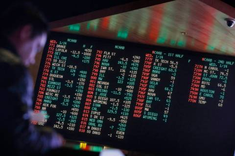 Odds are displayed on a screen at a sports book owned and operated by CG Technology in Las Vega ...