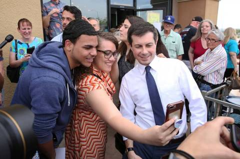Indiana's South Bend Mayor Pete Buttigieg, right, poses for a selfie with Cameron Mitchell and ...