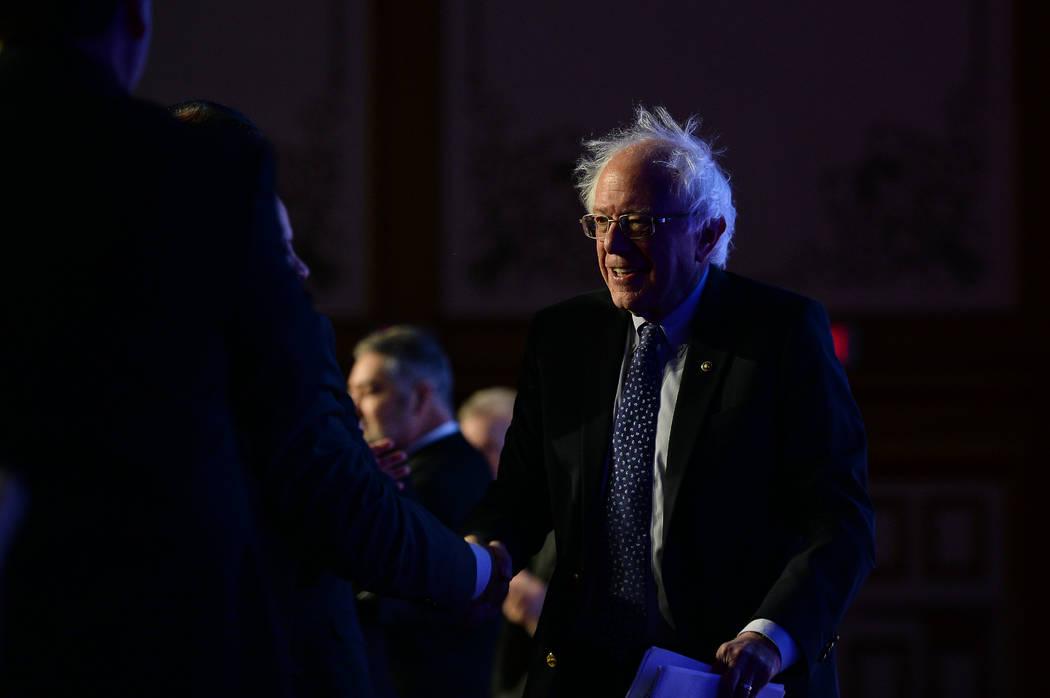 Democratic presidential candidate Sen. Bernie Sanders, I-Vt., greets people on stage before spe ...