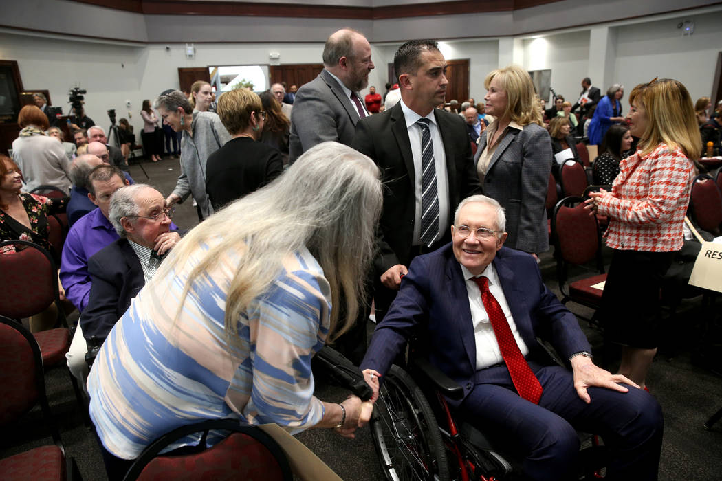 Former Sen. Harry Reid, greets Audrey Dempsey of Las Vegas before a panel on anti-Semitism in A ...