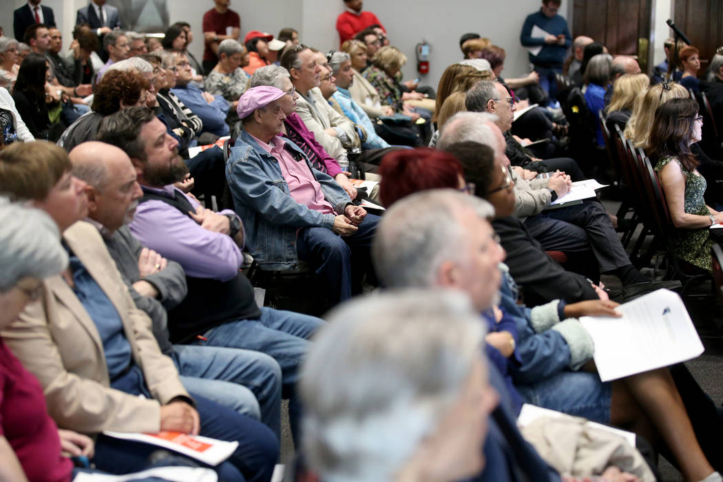 Audience members listen during a panel on anti-Semitism in America hosted by William S. Boyd Sc ...
