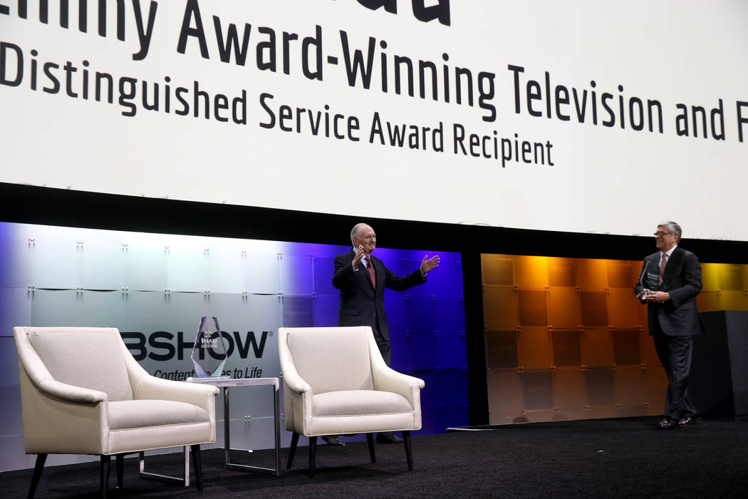 Actor, director, screenwriter and podcaster Alan Alda walks on stage to receive the Distinguish ...