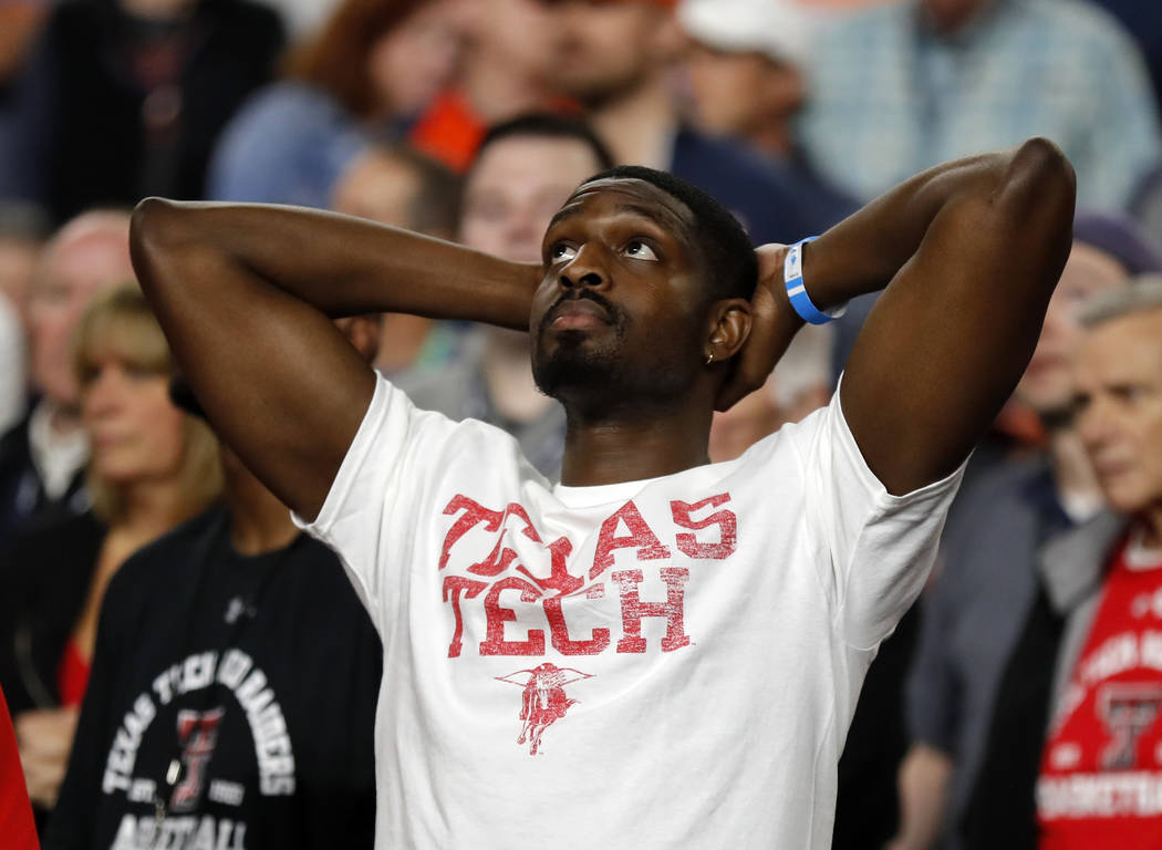 A Texas Tech fan reacts during the second half in the championship of the Final Four NCAA colle ...