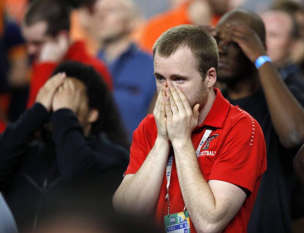 Texas Tech fans react during the second half in the championship of the Final Four NCAA college ...