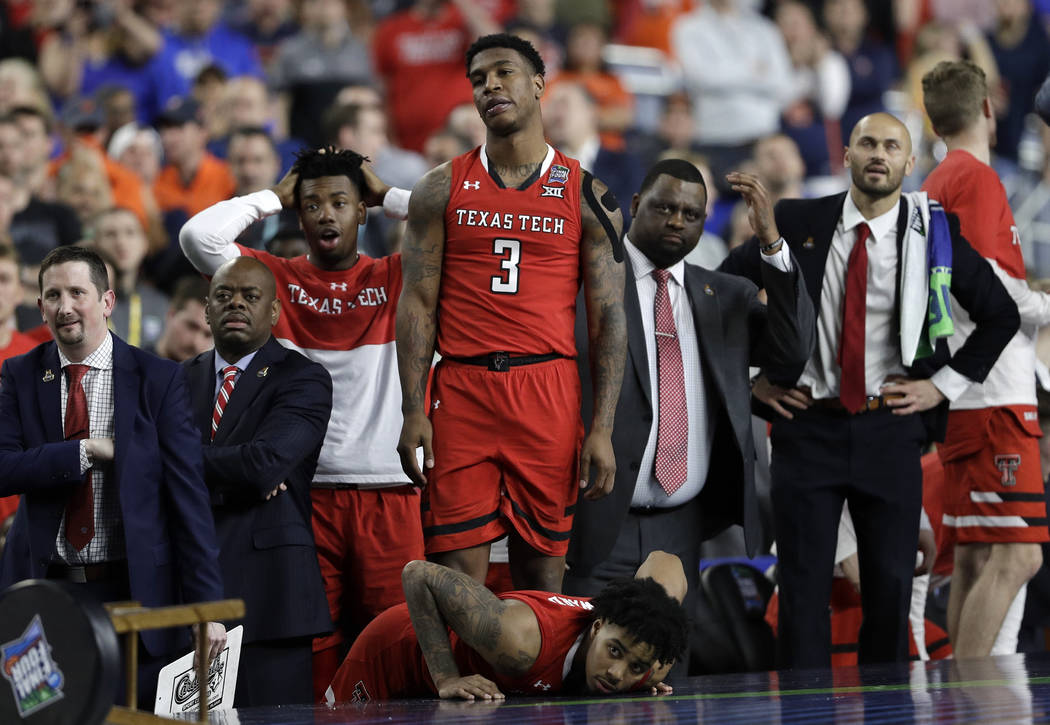 Texas Tech players react during the overtime in the championship of the Final Four NCAA college ...