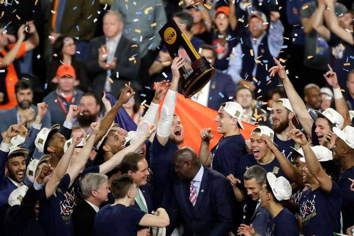 Virginia players celebrate with the trophy after defeating Texas Tech 85-77 in the championship ...