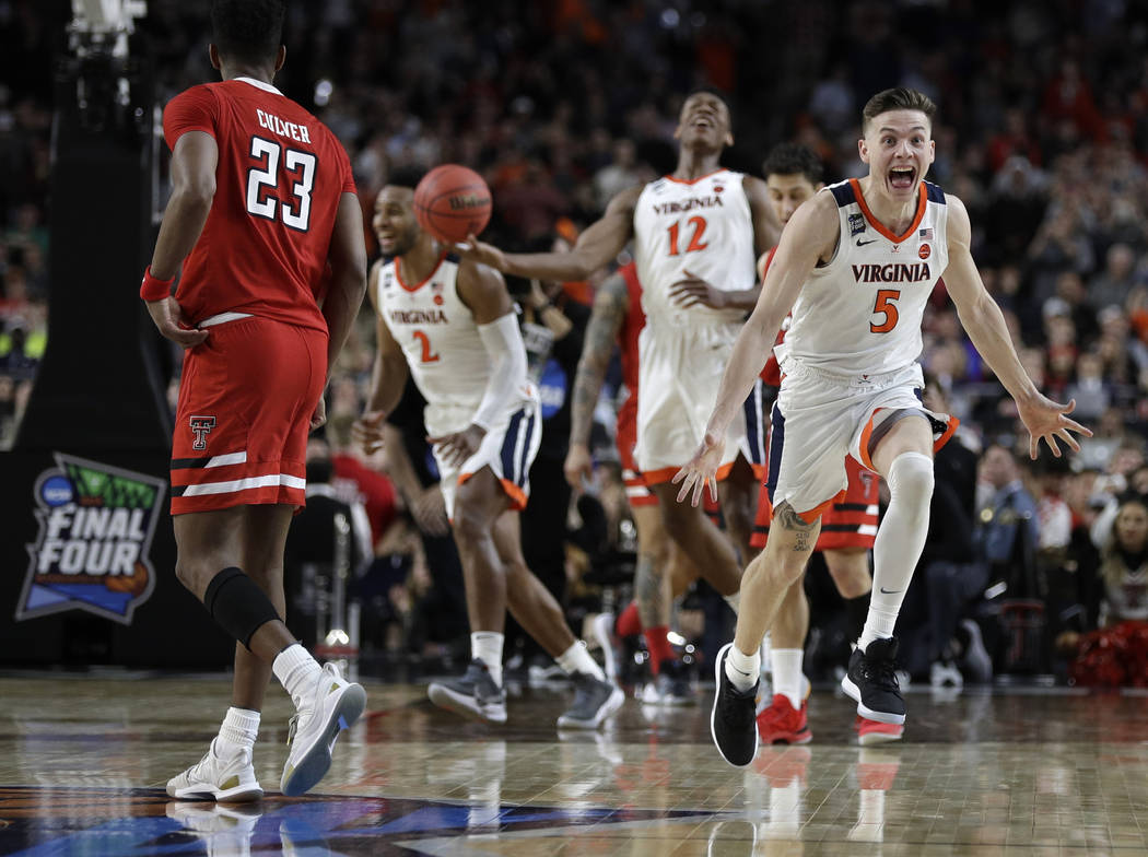 Virginia guard Kyle Guy (5) celebrates in front of Texas Tech guard Jarrett Culver (23) at the ...