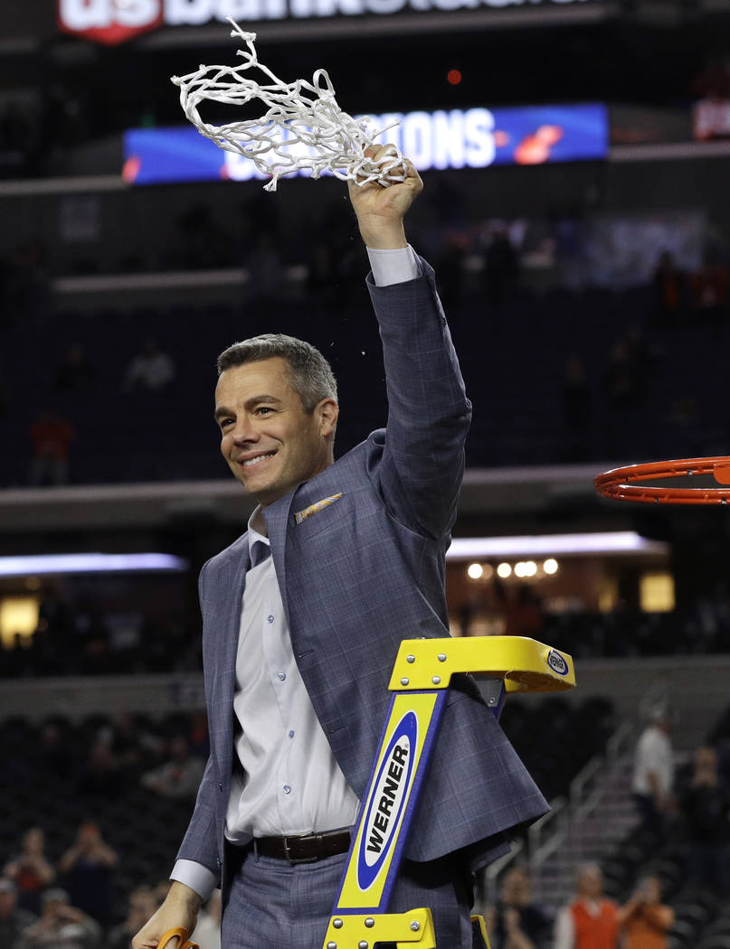 Virginia head coach Tony Bennett celebrates after cutting down the net following the championsh ...