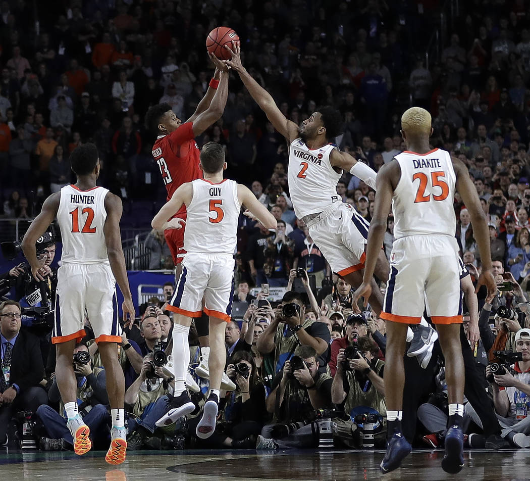 Virginia's Braxton Key (2) blocks a shot by Texas Tech's Jarrett Culver (23) during the second ...