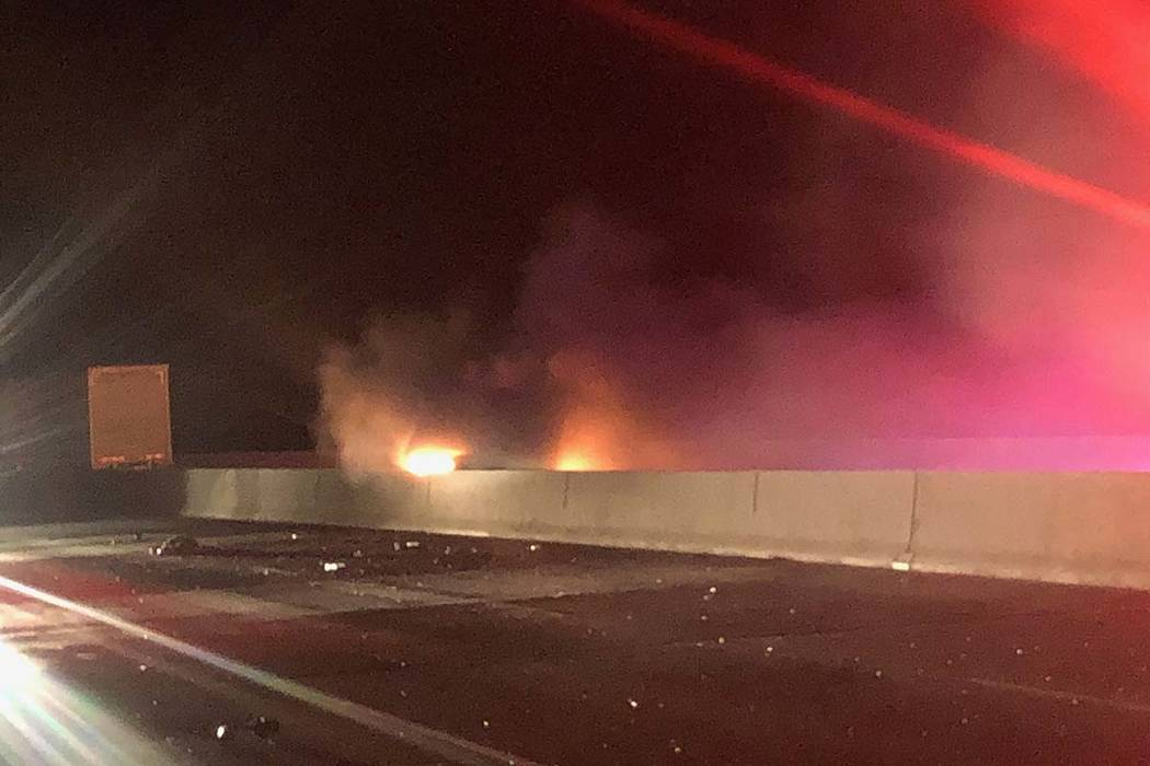 A vehicle burns as first responders arrive at a two-vehicle crash just a mile north of the Hoov ...