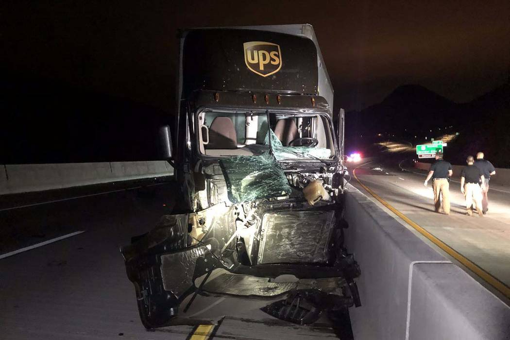 A UPS tractor-trailer sustained severe damage in a head-on crash with another vehicle on the H ...
