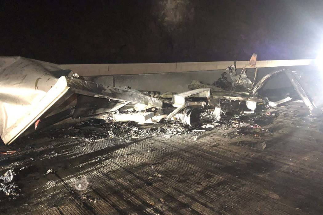 Debris lies on the roadway from a head-on crash between two vehicles near the Hoover Dam bypass ...
