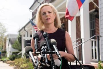 Homeland Security Secretary Kirstjen Nielsen talks outside her home in Alexandria, Va., on Mond ...