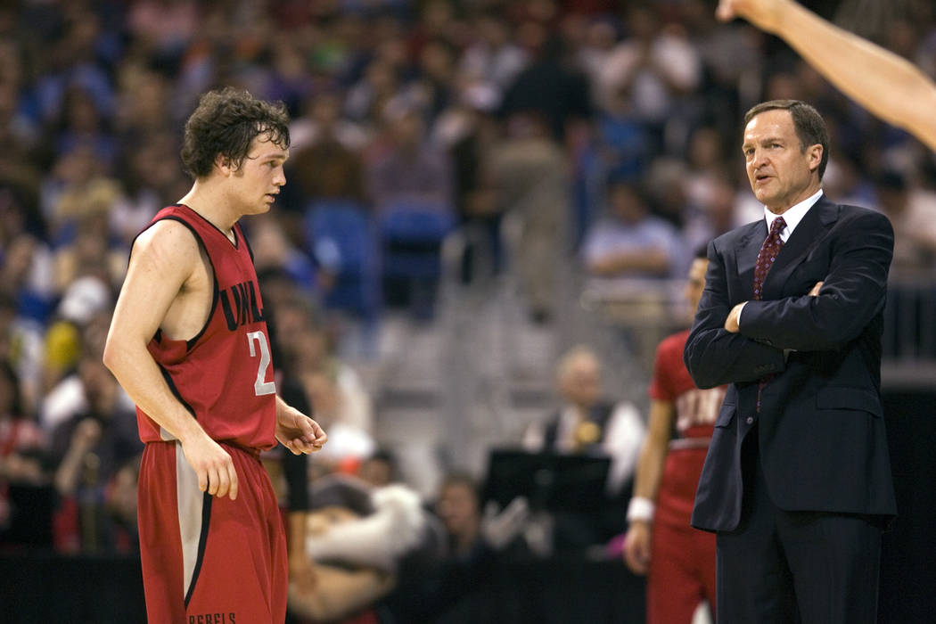 UNLV point guard Kevin Kruger looks to his father Lon Kruger as Oregon takes a free throw in th ...