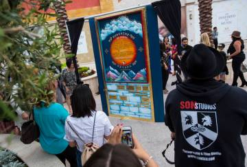 Attendees check out the Sunshine Nevada donor wall after it is unveiled at Tivoli Village in La ...