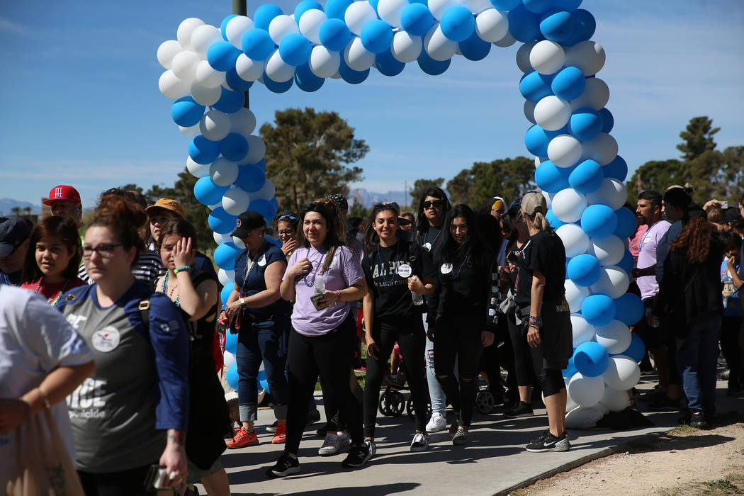 People participate during the Out of the Darkness Community Walk at Craig Ranch Park in North L ...