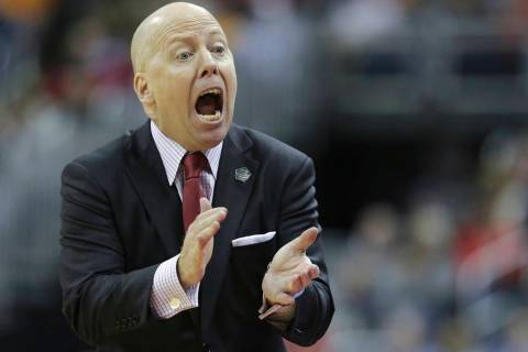 In this March 22, 2019, file photo, Cincinnati head coach Mick Cronin encourages his team in th ...
