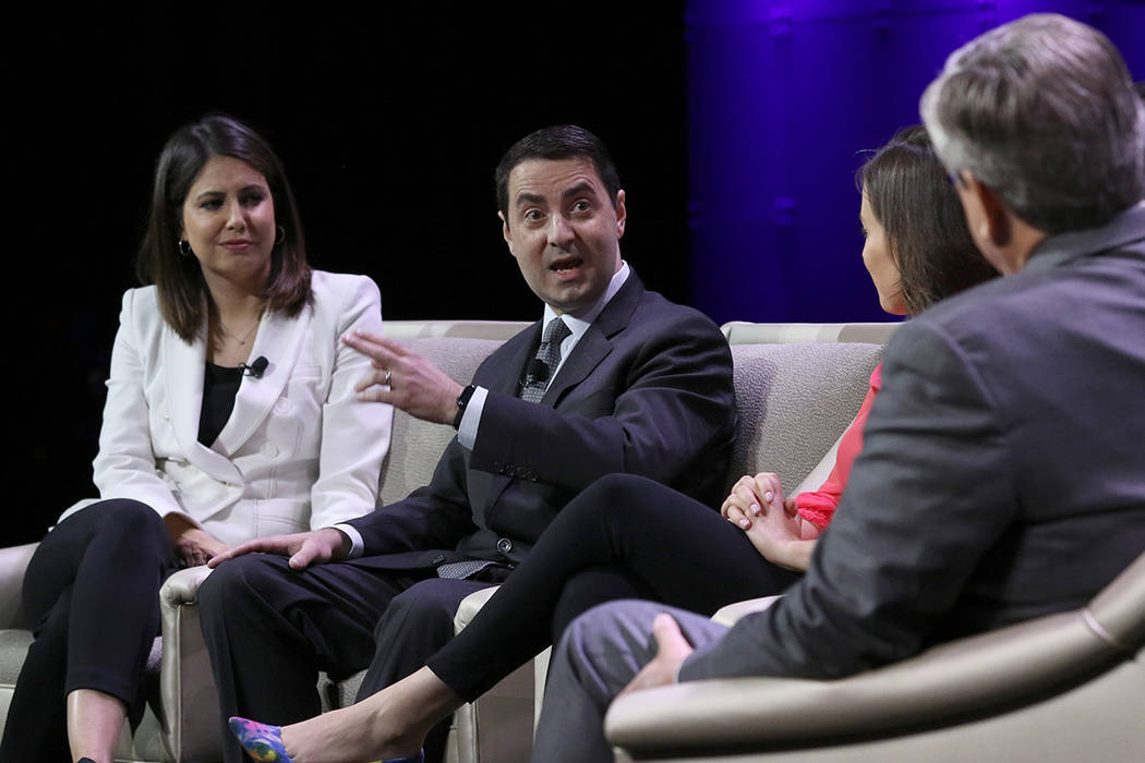 Steven Portnoy, second left, White House Correspondent at CBS, speaks during a panel discussion ...