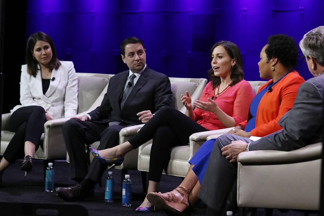 Hallie Jackson, center, chief White House Correspondent at NBC, speaks during a panel discussio ...