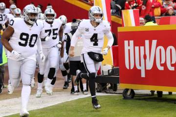 Oakland Raiders quarterback Derek Carr (4) leads his team on the field before the start of an N ...