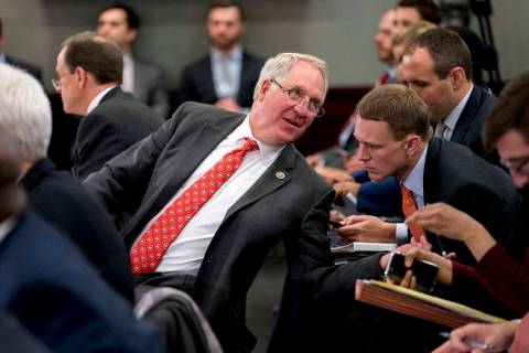Rep. John Shimkus, R-Ill., speaks with an aide during a House and Senate conference on Capitol ...