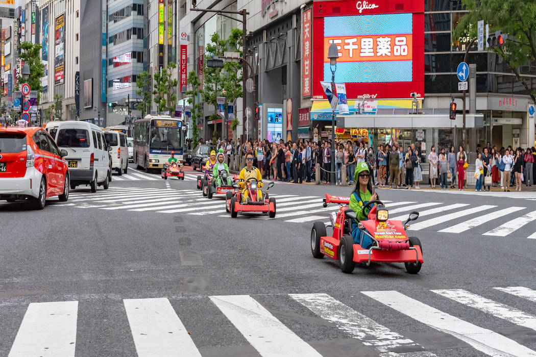 "Participants compete in a ""Mario Kart"" race in Shibuya, Tokyo. (Getty Images_"