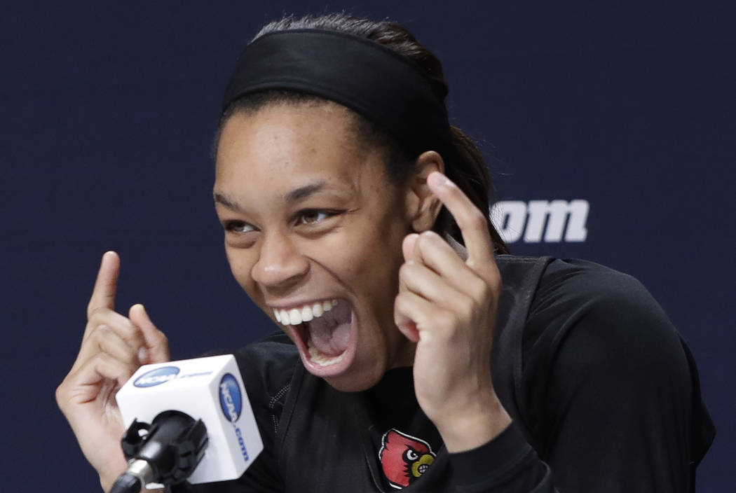 Louisville guard Asia Durr laughs as she tells a joke during a news conference at the NCAA wome ...