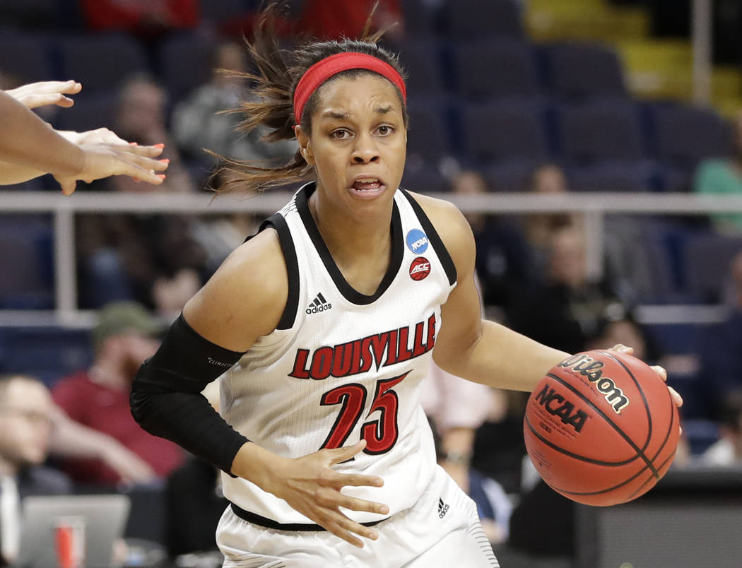 Louisville guard Asia Durr (25) drives trhough traffic during the second half of a regional sem ...