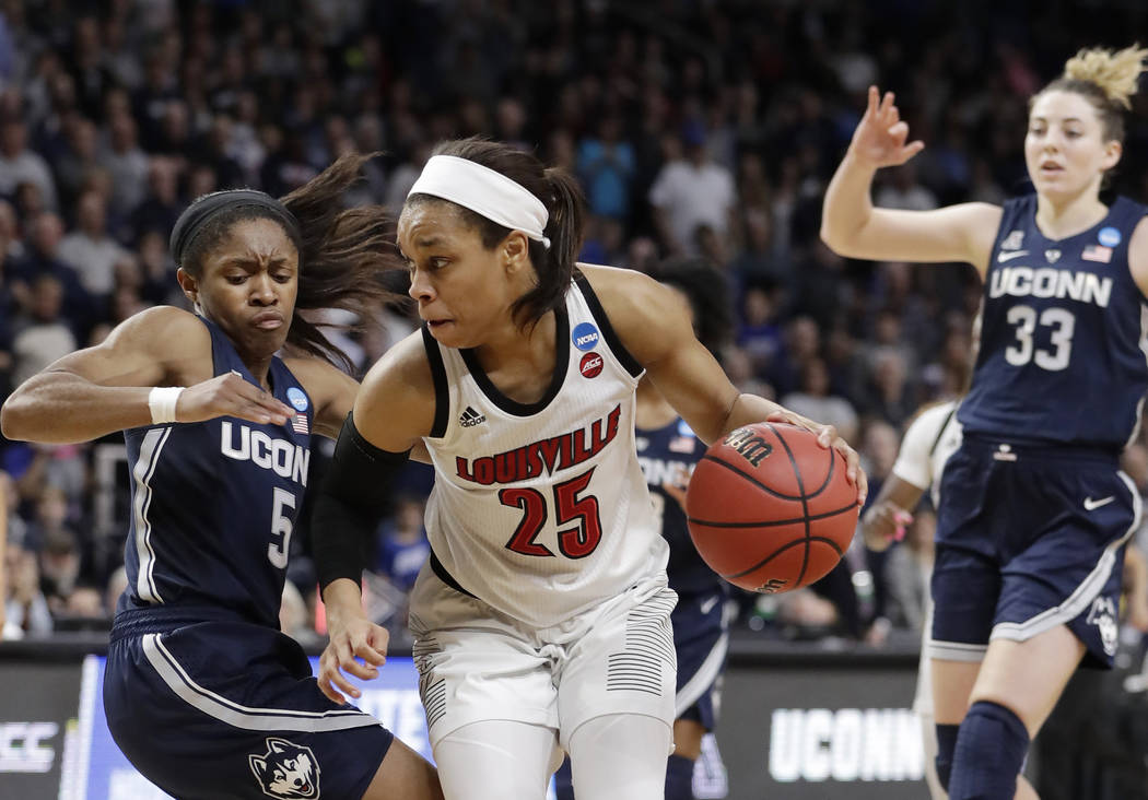 Connecticut guard Crystal Dangerfield (5) defends against Louisville guard Asia Durr (25) as Co ...