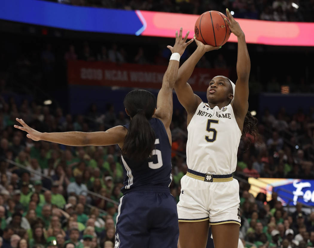 Notre Dame guard Jackie Young shoots over Connecticut guard Crystal Dangerfield during the firs ...