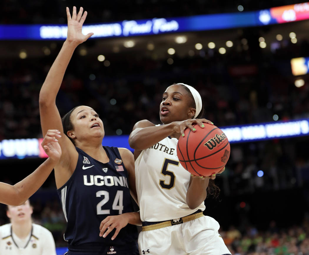 Notre Dame guard Jackie Young (5) drives to the basket as Connecticut forward Napheesa Collier ...