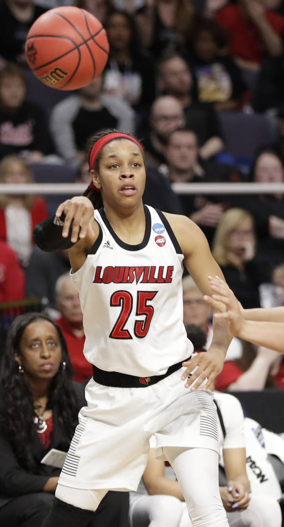 Louisville guard Asia Durr (25) passes during the second half of a regional semifinal game agai ...