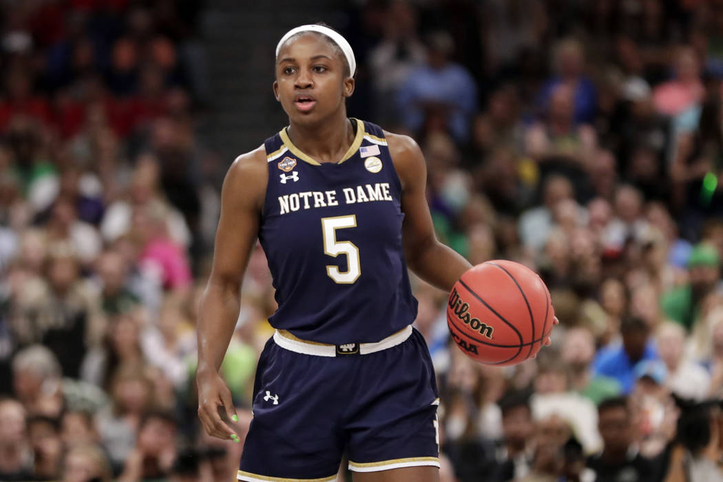 Notre Dame guard Jackie Young (5) dribbles the ball, during the second half of the Final Four c ...