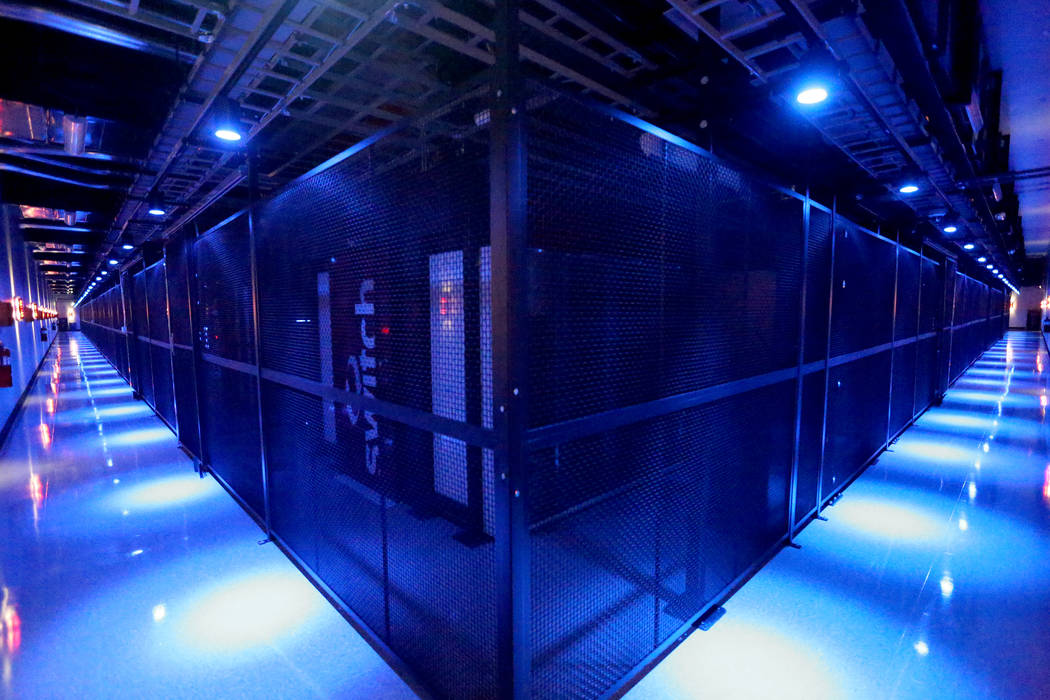 The Switch Data Sector houses rows of multi-cabinet heat containment chimney pods that channel ...