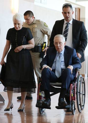 Former U.S. Sen. Harry Reid and his wife, Landra Gould, leave a courtroom at the Regional Justi ...