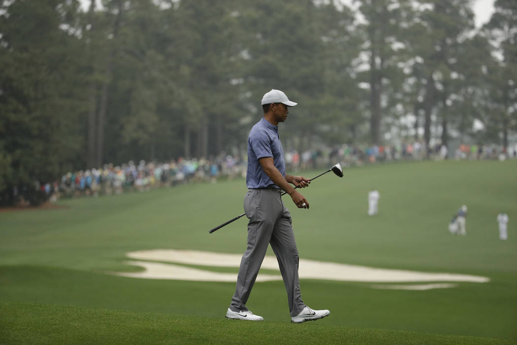 Tiger Woods walks off the 11th tee during a practice round for the Masters golf tournament Mond ...