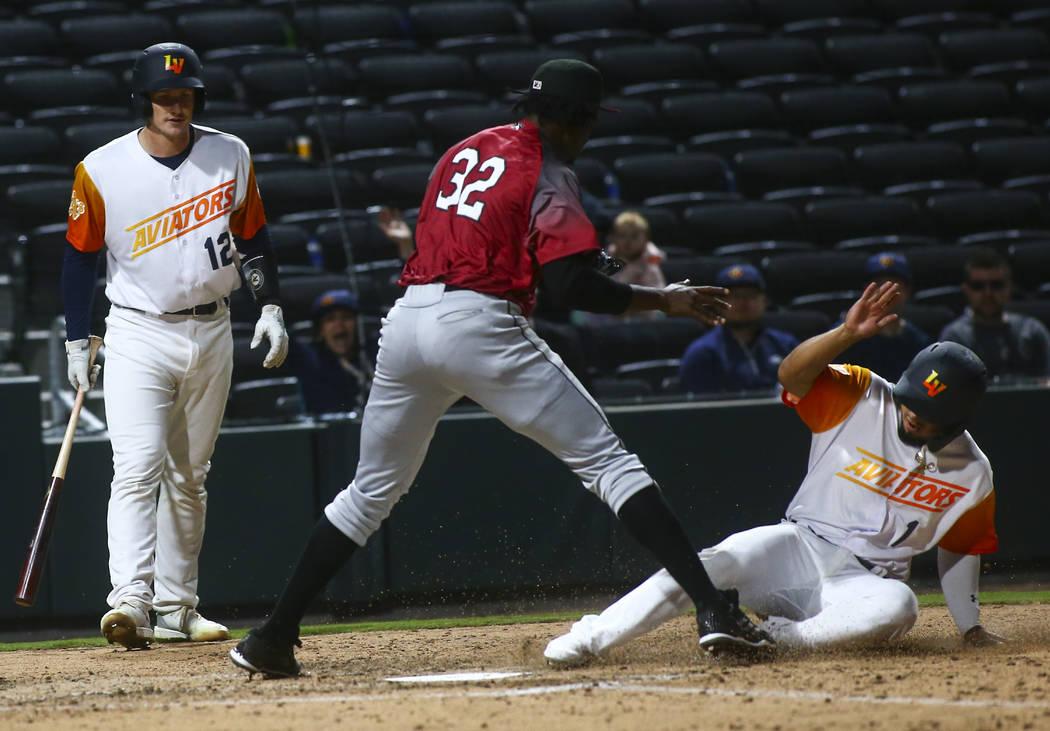 Las Vegas Aviators second baseman Franklin Barreto (1) scores a run against Sacramento River Ca ...