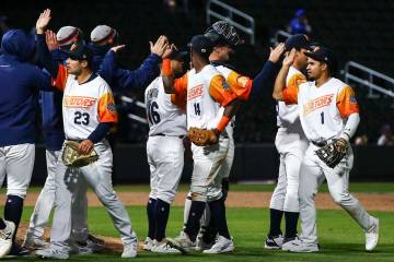Las Vegas Aviators players celebrate a 10-2 win over the Sacramento River Cats in their home op ...