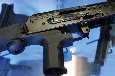 """A """"bump stock"""" is attached to a semi-automatic rifle at the Gun Vault store and shooting range ..."""